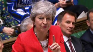 La Première ministre britannique Theresa May a défendu son accord sur le Brexit devant les députés avant le vote, mardi 12 mars.
