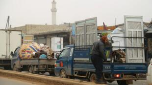 Trucks carry belongings of people fleeing from Maarat al-Numan, in northern Idlib, Syria, on December 24, 2019.