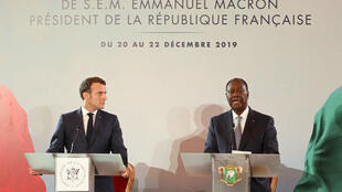 France's President Emmanuel Macron and Ivory Coast President Alassane Ouattara give a joint news conference at the Petit Palais in Abidjan on December 21, 2019.