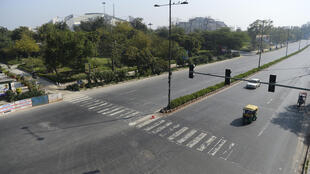 Roads are deserted during a one-day Janata (civil) curfew imposed as a preventive measure against the COVID-19 coronavirus, in New Delhi on March 22, 2020.