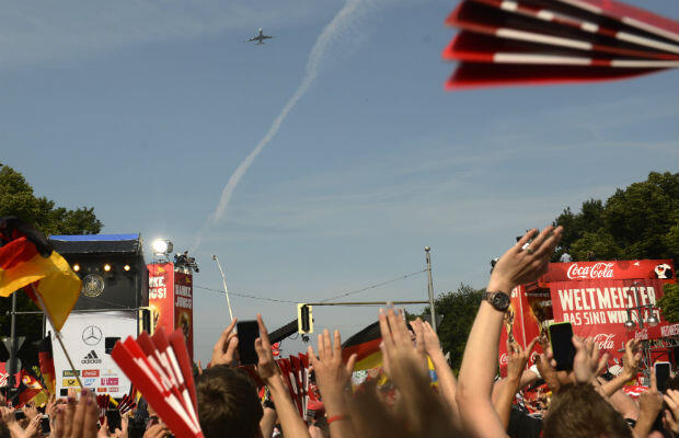 Thousands of fans gathered at the Bradenburg Gate in Berlin cheered the team's plane as it passed overhead. AFP - Robert Michael