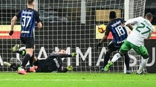 Inter Milan goalkeeper Samir Handanovic rescued a point, denying Sassuolo's Ghanaian forward Kevin-Prince Boateng