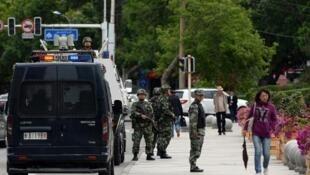 الشرطة شبه العسكرية الصينية في أورومتشي عاصمة شينجيانغ في 23 أيار/مايو 2014