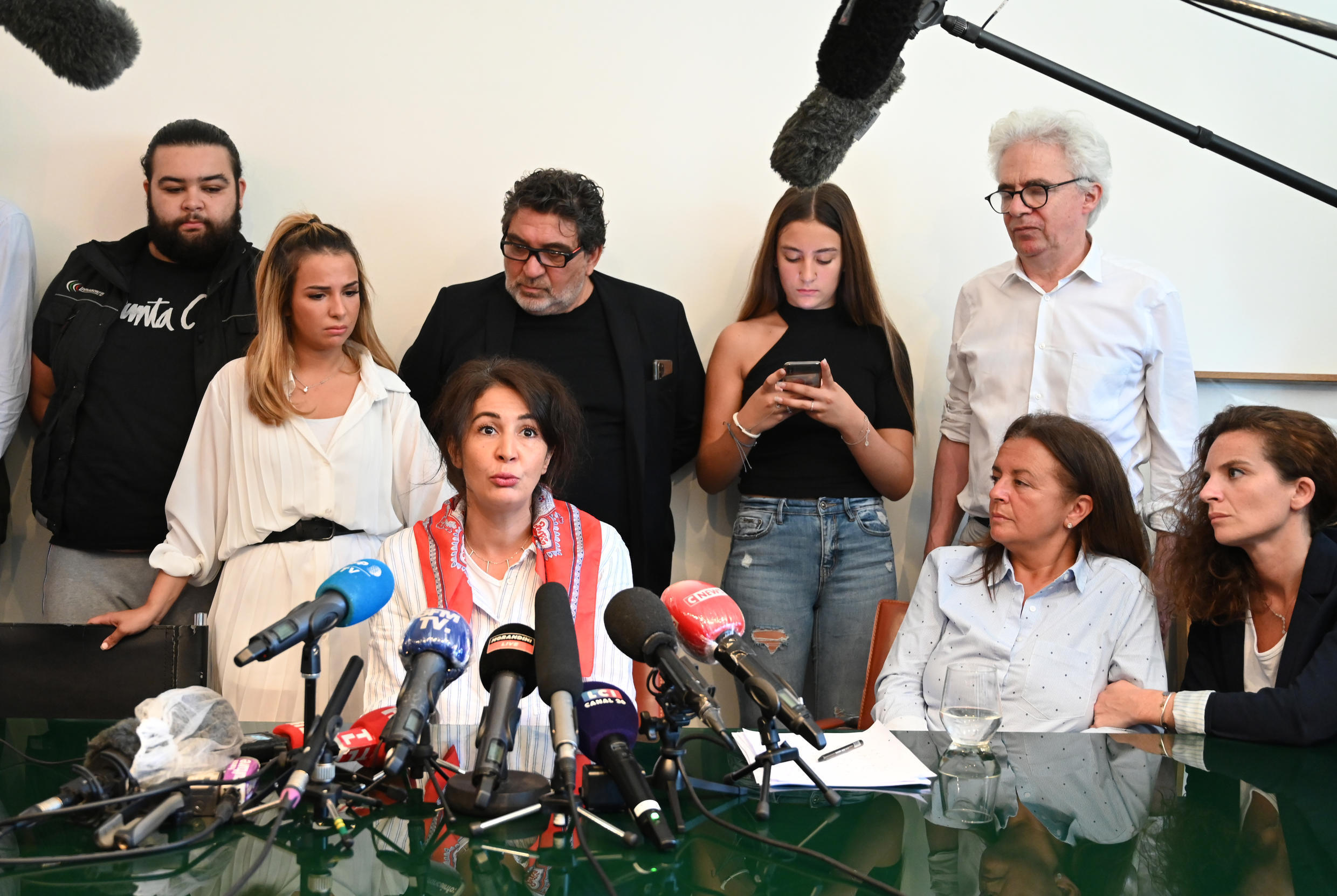 Doria Chouviat (C), the widow of Cedric Chouviat, a delivery driver who died after being pinned to the ground by arresting police officers in January 2020, speaks at a press conference in Paris, on June 23, 2020.
