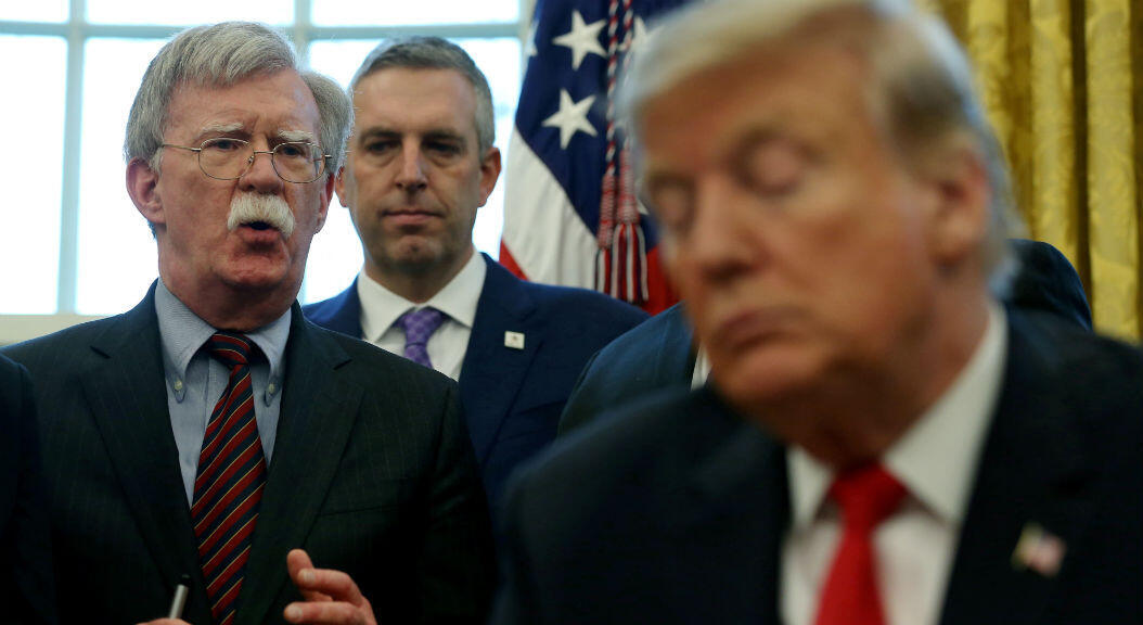 FILE PHOTO: US President Donald Trump with his former national security advisor John Bolton, in Washington, D.C. on February 7, 2019.