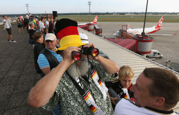 Some fans watched the team's arrival through binoculars. AFP - Adam Berry