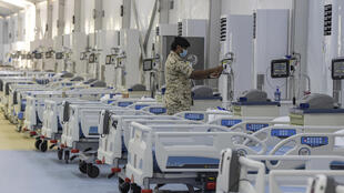 A member of the Bahraini security forces checks patient monitoring equipment at the Sitra field Intensive Care Unit (ICU) hospital for COVID-19 patients on Sitra island south of the capital Manama