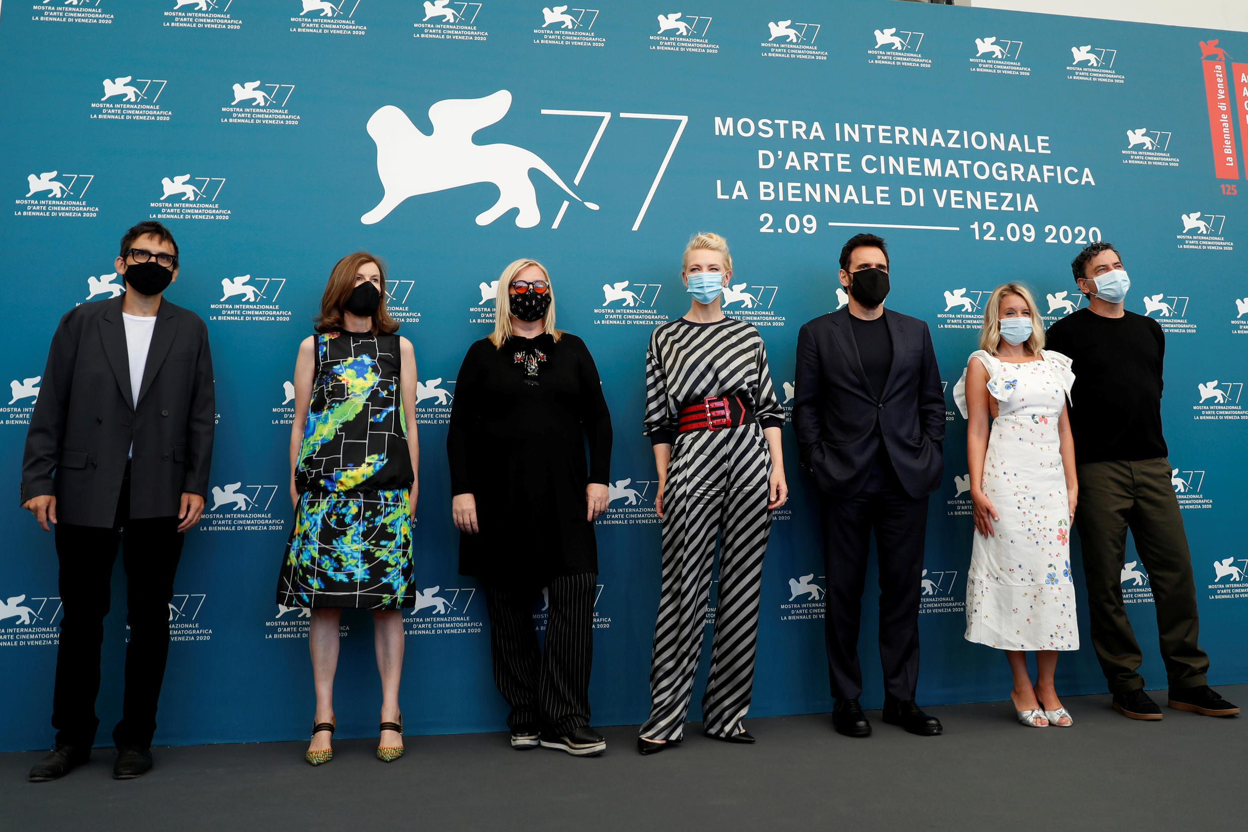 Led by Cate Blanchett, jury members pose at the start of the 77th Venice Film Festival.