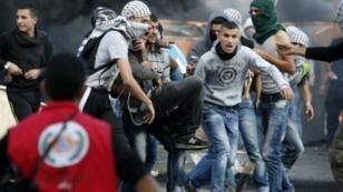 متظاهرون فلسطينيون قرب رام الله في 9 أكتبور 2015