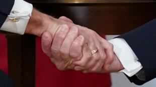031219-trump-macron-hands-m