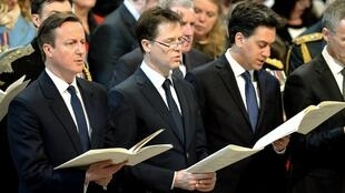 Singing off the same hymn sheet? David Cameron, Liberal Democrat leader Nick Clegg and Labour leader Ed Miliband attend a memorial service to mark the end of combat operations in Afghanistan.