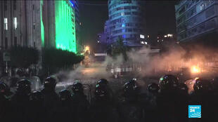 Riot police stand guard during a protest in Lebanon.