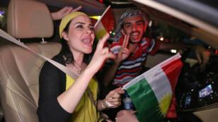 Des Kurdes d'Irak célèbrent à Erbil les prémices de l'indépendance à l'issue du vote au référendum d'autodétermination de leur région, lundi 25 septembre.