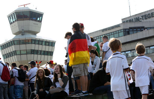 Fans wait for the Germany team's flight from Brazil to arrive at Berlin's Tegel Airport. AFP - Adam Berry