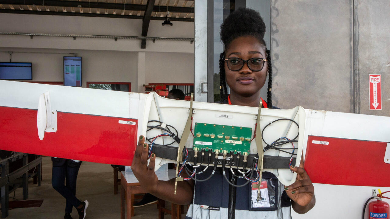 Staff member Georgina Wilson holds a part of a drone during preparations for the delivery of medical supplies at the drone delivery service base run by operator Zipline in Omenako, 70km north of Accra, Ghana, on April 23, 2019.