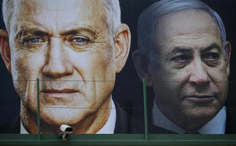 An Israeli election banner taken in February shows Benny Gantz, on the left, and Prime Minister Benjamin Netanyahu