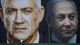 An Israeli election banner taken in February shows Benny Gantz, on the left, and Prime Minister Benjamin Netanyahu