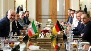 France and Germany have been at the forefront of efforts to keep the nuclear deal alive, with Berlin's top diplomat Heiko Maas, seen on the right, visiting Iran earlier this month