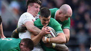 Irish rugby stars such as Johnny Sexton (centre)have agreed to wage cuts and deferrals