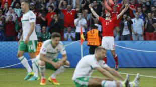 Le Gallois Gareth Bale exulte après l'ouverture du score face à l'Irlande du nord, le 25 juin 2016.