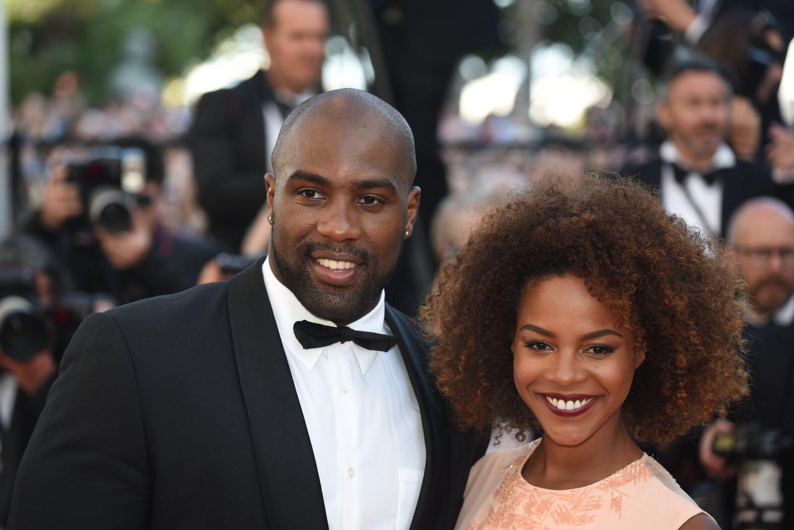 "French-born judo world champion Teddy Riner walks the red carpet with his partner Luthna Plocus to attend the ""Elle"" premiere."