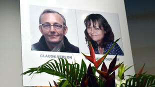 File photo taken Nov. 2, 2018 in Ivory Coast shows posters of RFI journalists Ghislaine Dupont (R) and Claude Verlon