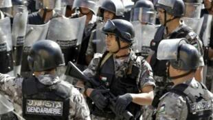 شرطة مكافحة الشغب الأردنية خلال تظاهرة في عمان في 16 تشرين الأول/أكتوبر