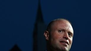 Malta's Prime Minister Joseph Muscat speaks to the media as he arrives in Salzburg, Austria on September 19, 2018 prior to a dinner as part of the EU Informal Summit of Heads of State or Government
