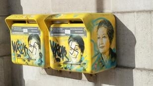 """French society is in trouble,"" the son of the late Simone Veil said as he looked at the swastikas daubed on two post boxes decorated with pictures of his mother, a Holocaust survivor"