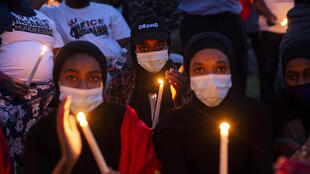 A candlelight vigil for the late musician and activist Haacaaluu Hundeessaa at the Oromo Community of Minnesota building in St Paul, Minnesota, on June 30, 2020.