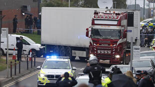 Police escort the truck that was found to contain a large number of dead bodies, moving it from an industrial estate in Thurrock, south England on October 23, 2019.