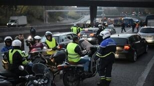 """""""Yellow vest"""" protesters angry over high fuel prices snarled traffic on the ring road around Paris on Saturday"""