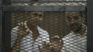 Le journaliste australien Peter Greste et l'Égyptien Mohamed Baher