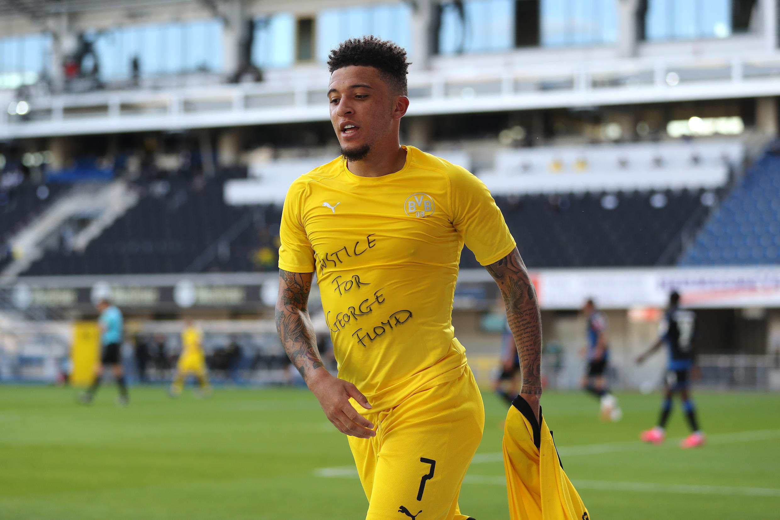 "Dortmund winger Jadon Sancho displays a ""Justice for George Floyd"" shirt on May 31, 2020."