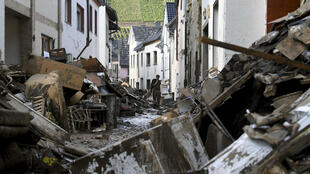 Emergency workers in Germany have been racing to assess damaged buildings, clear debris and restore key services