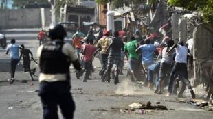 Échauffourrées entre police et manifestants à Port-au-Prince, mercredi 13 février 2019.