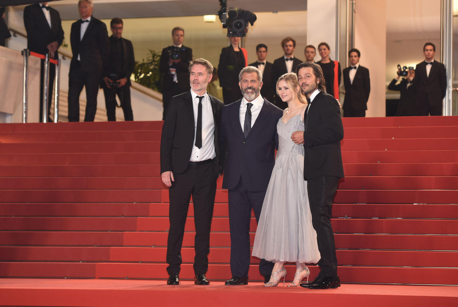 "French director Jean-François Richet (left) poses with cast members Mel Gibson, Diego Luna and Erin Moriarty from his film ""Blood Father"", before the movie's midnight screening."