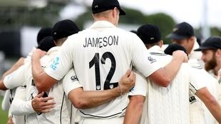 New Zealand's players huddle during the second cricket Test match between New Zealand and Pakistan in Christchurch on January 5, 2021