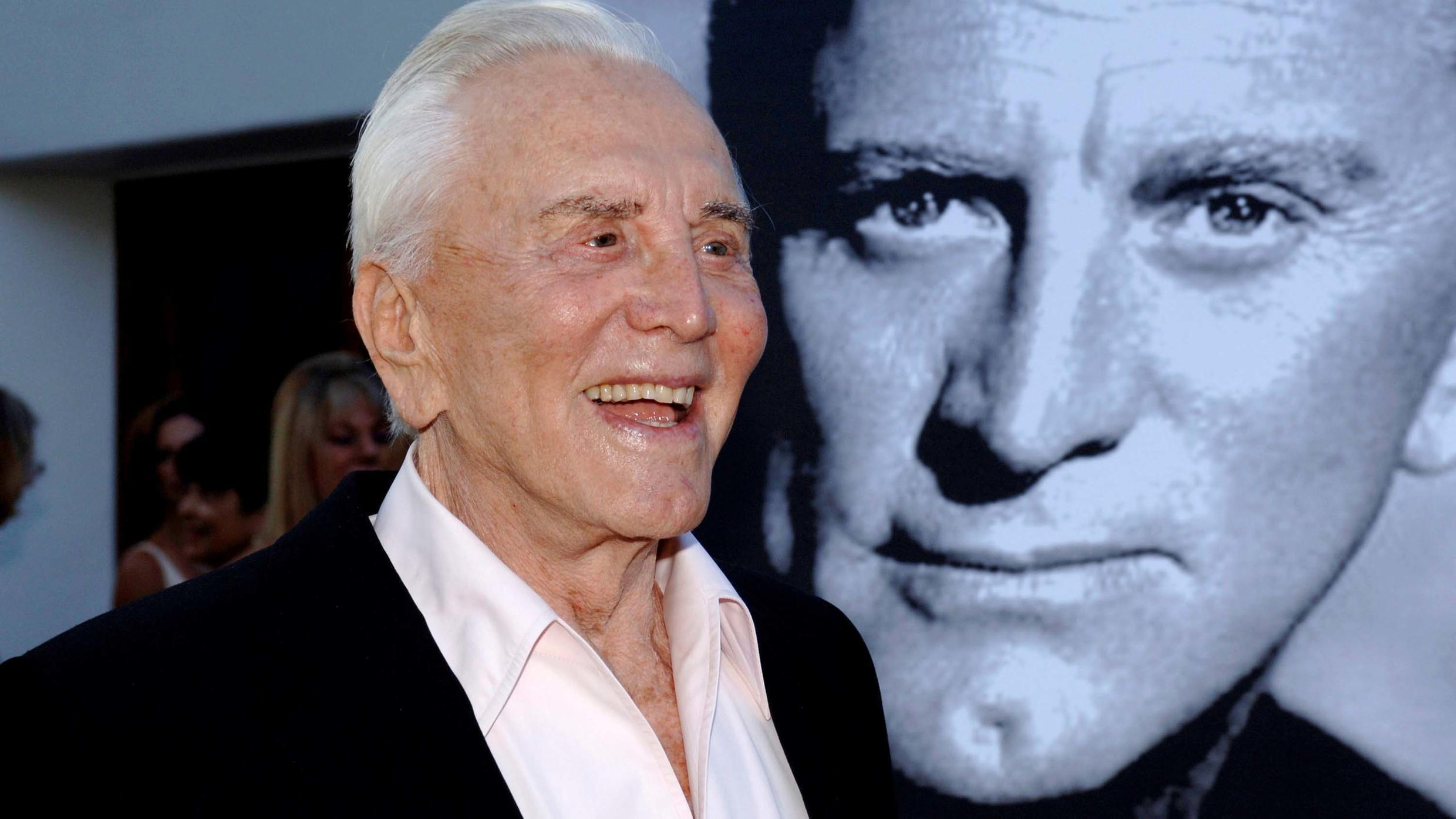 "Kirk Douglas arrives to receive an inaugural award for ""excellence in film"", presented by the Santa Barbara International Film Festival at a black-tie gala fundraiser in his honour in Santa Barbara, California, July 30, 2006."