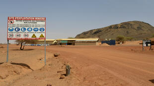 A sign is posted at the entrance of the Tambao mine in Tambao, 350 kilometres northeast of the capital, Ouagadougou on April 5, 2015, where five armed men kidnapped a Romanian mineworker the day before.