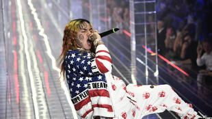 """American rapper Tekashi 69, shown here performing in Milan in 2018, rapped with Nine Trey Gangsta Bloods wearing trademark red bandanas in the video for """"Gunmo"""" -- but turned on his former associates as a star witness in the sweeping trial"""