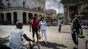 Shoppers wear protective face masks to fight the pandemic as they do their shopping in Havana, Cuba, Tuesday, Jan. 19, 2021
