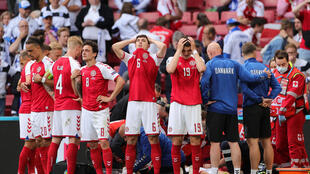 Denmark's distraught players form a ring as paramedics attend to Christian Eriksen after his collapse