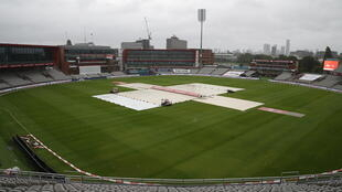 Waiting game - Covers protect the pitch as rain delays the start of the fourth day's play in the third Test between England and the West Indies at Old Trafford on Monday