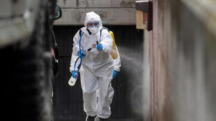 A member of the Military Emergencies Unit (UME) carries out a general disinfection at the Betesda Foundation for the mentally disabled in Madrid on March 27, 2020.