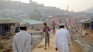 Rohingya refugees walk on a road at the Balukhali camp in Cox's Bazar, Bangladesh on April 8, 2019.