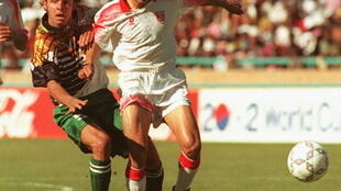 Mark Fish (L) playing in the 1996 Africa Cup of Nations final against Tunisia, which South Africa won 2-0 in Soweto
