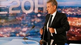 French former president Nicolas Sarkozy reacts as he is interviewed by journalist Gilles Bouleau (unseen) in the studio set of French television channel TF1's evening news on March 3, 2021 in Boulogne Billancourt, on the outskirts of Paris.