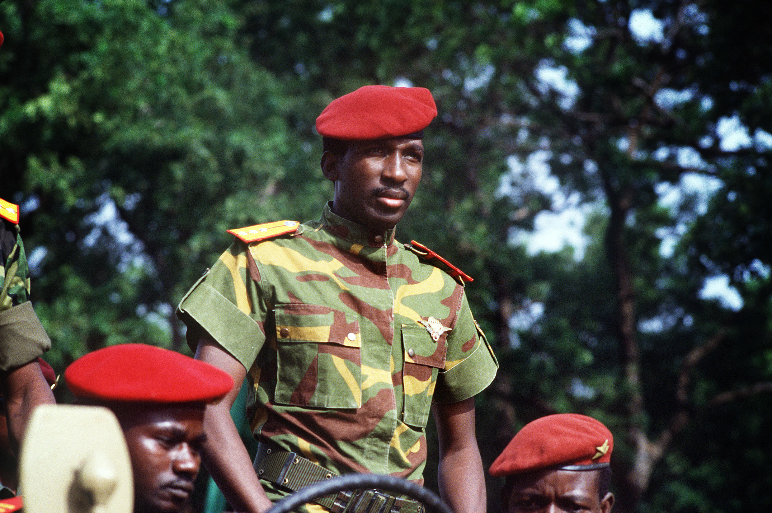 Thomas Sankara celebrates the second anniversary of Burkina Faso's revolution on August 4, 1985, with a suitably green backdrop.