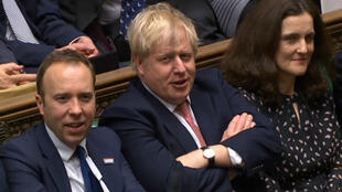 A video grab from footage broadcast by the UK Parliament's Parliamentary Recording Unit shows Britain's Prime Minister Boris Johnson (C) reacting after his Government won the vote on the third reading of the EU (Withdrawal Agreement) Bill, in the House of Commons in London on January 9, 2020.